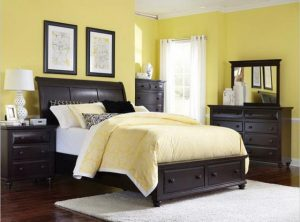 Pale yellow bedroom walls with dark wood furniture - Control the hue when decorating with shades of yellow paint