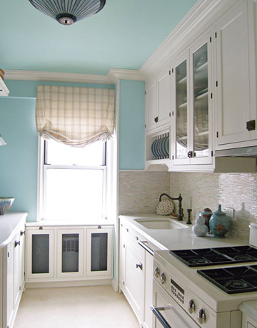 shades of blue paint - pale blue walls in white kitchen